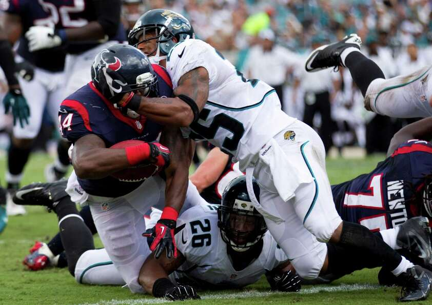Houston Texans running back Ben Tate (44) powers past Jacksonville Jaguars strong safety Dwight Lowe