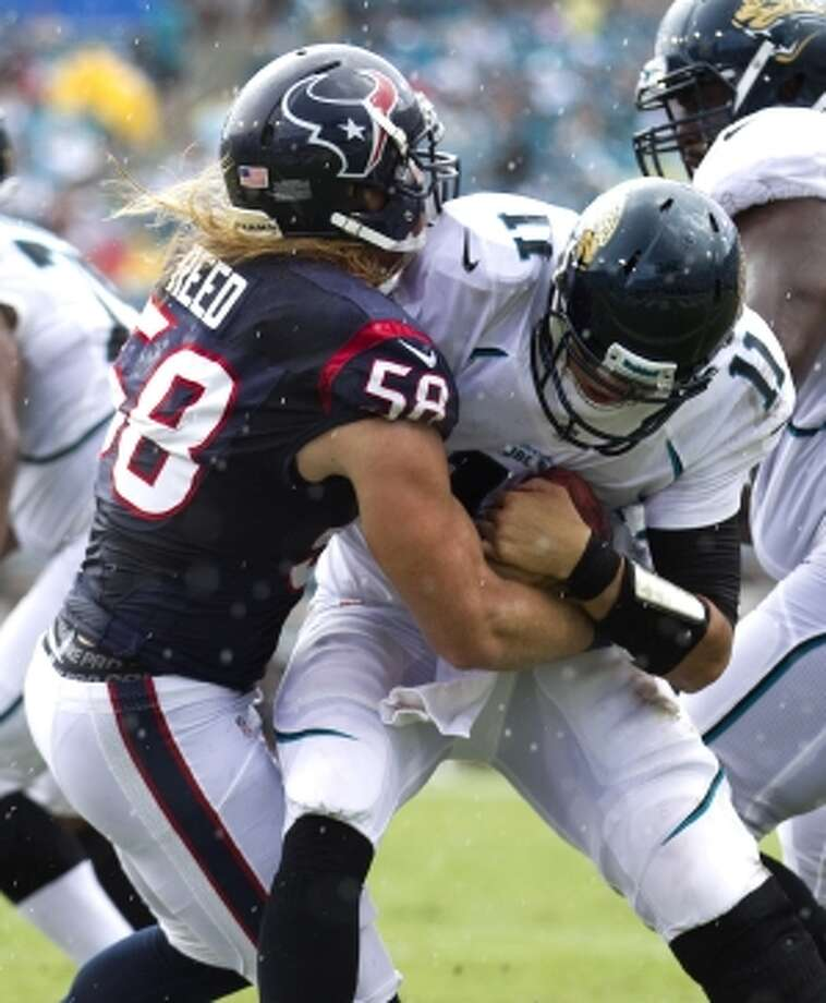 Houston Texans outside linebacker Brooks Reed records a quarterback sack in the second quarter. (Brett Coomer / © 2012  Houston Chronicle)