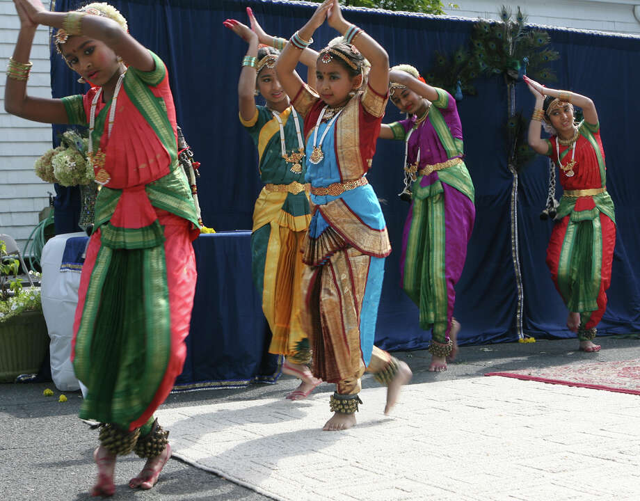 Dancers perform at the 6th Annual Heritage India Festival on the town green in Fairfield, Conn. on Sunday, September 16, 2012.  The Hindu Center of Connecticut sponsored the event. Photo: Unknown, B.K. Angeletti / Connecticut Post freelance B.K. Angeletti