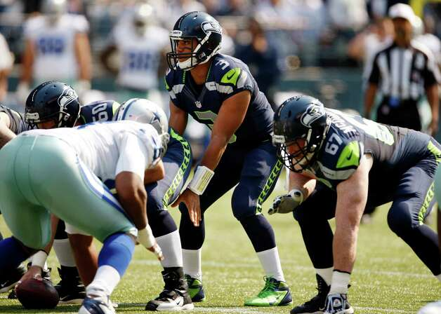Seattle Seahawks quarterback Russell Wilson lines-up on the team's first play against the Dallas Cowboys in the first half of an NFL football game, Sunday, Sept. 16, 2012, in Seattle. (AP Photo/Kevin P. Casey) Photo: Kevin P. Casey, Associated Press / FR132181 AP