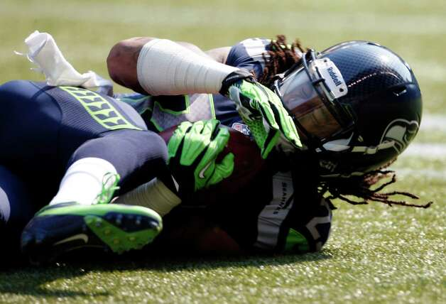 Seattle Seahawks' Earl Thomas recovers a fumble by the Dallas Cowboys in the opening kickoff return in the first half of an NFL football game on Sunday, Sept. 16, 2012, in Seattle. (AP Photo/Kevin P. Casey) Photo: Kevin P. Casey, Associated Press / FR132181 AP