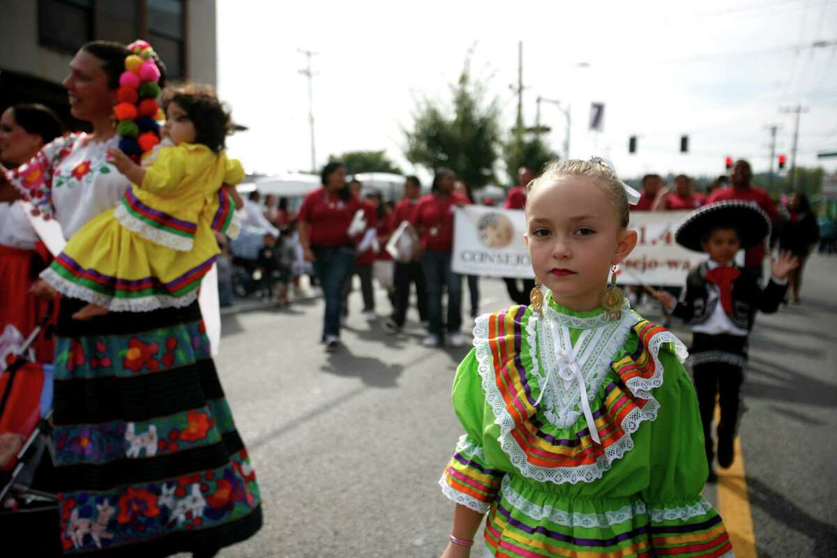 A young girl wears a traditional Mexican dress.