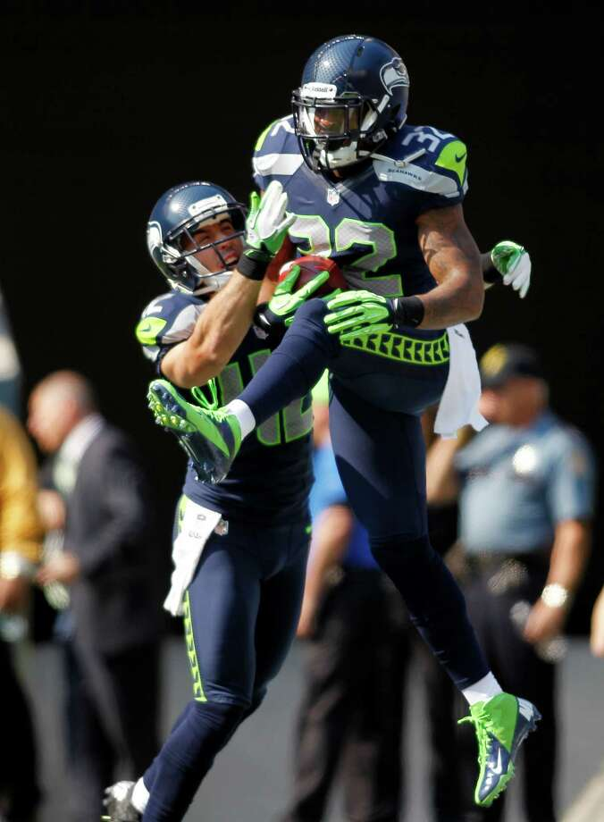 Seattle Seahawks' Jeron Johnson, right, celebrates his touchdown with Chris Maragos against the Dallas Cowboys in the first half of an NFL football game on Sunday, Sept. 16, 2012, in Seattle. Photo: AP