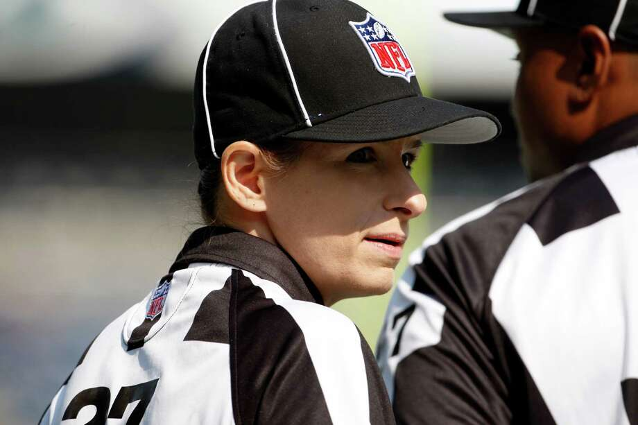 Official Shannon Eastin talks with another official before the NFL football game between the Dallas Cowboys and Seattle Seahawks, Sunday, Sept. 16, 2012, in Seattle. Photo: AP