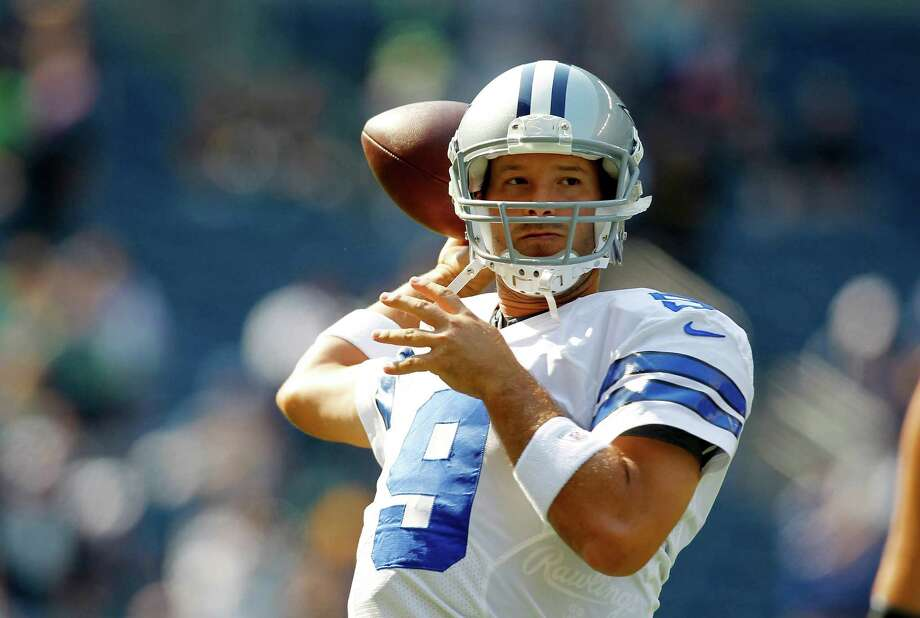 Dallas Cowboys quarterback Tony Romo throws in warm ups before an NFL football game against the Seattle Seahawks, Sunday, Sept. 16, 2012, in Seattle. Photo: AP