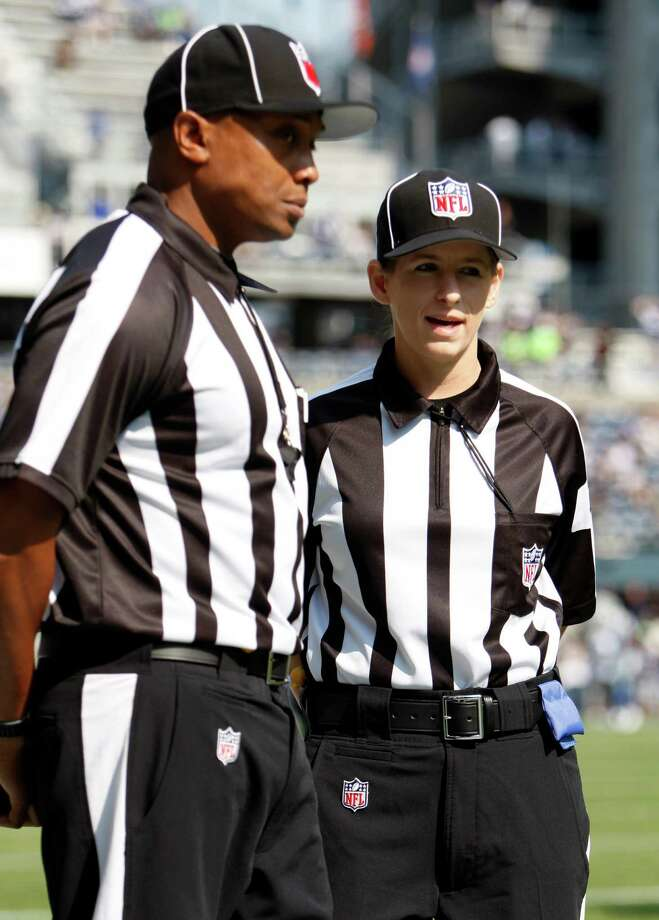 Official Shannon Eastin, right, talks with another official before the NFL football game between the Dallas Cowboys and Seattle Seahawks, Sunday, Sept. 16, 2012, in Seattle. Photo: AP