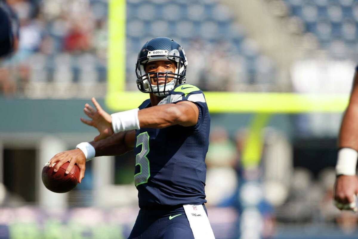 Seattle Seahawks quarterback Russell Wilson throws before an NFL football game against the Dallas Cowboys, Sunday, Sept. 16, 2012, in Seattle.