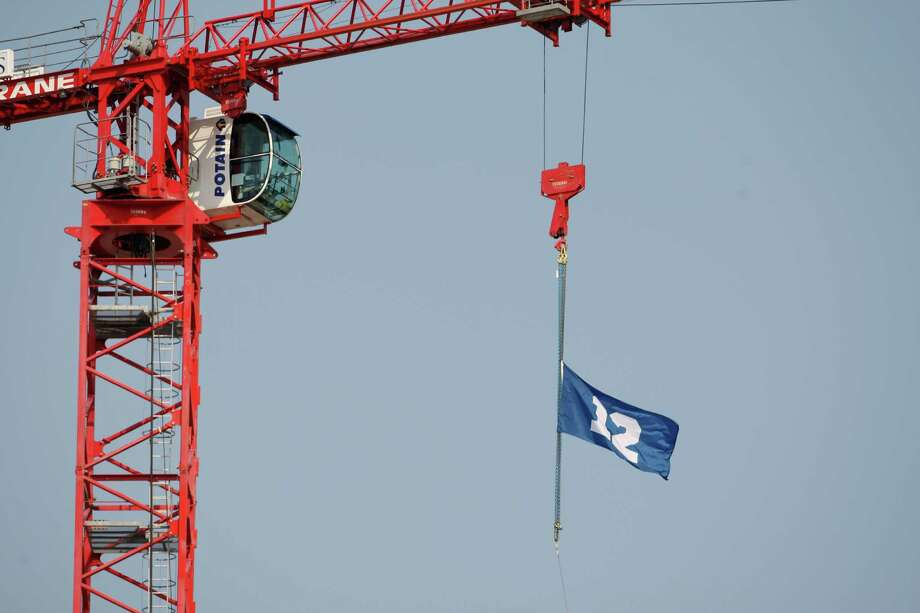 "A fan ""12th Man"" flag flies outside the stadium before the NFL football game between the Dallas Cowboys and Seattle Seahawks, Sunday, Sept. 16, 2012, in Seattle. Photo: AP"