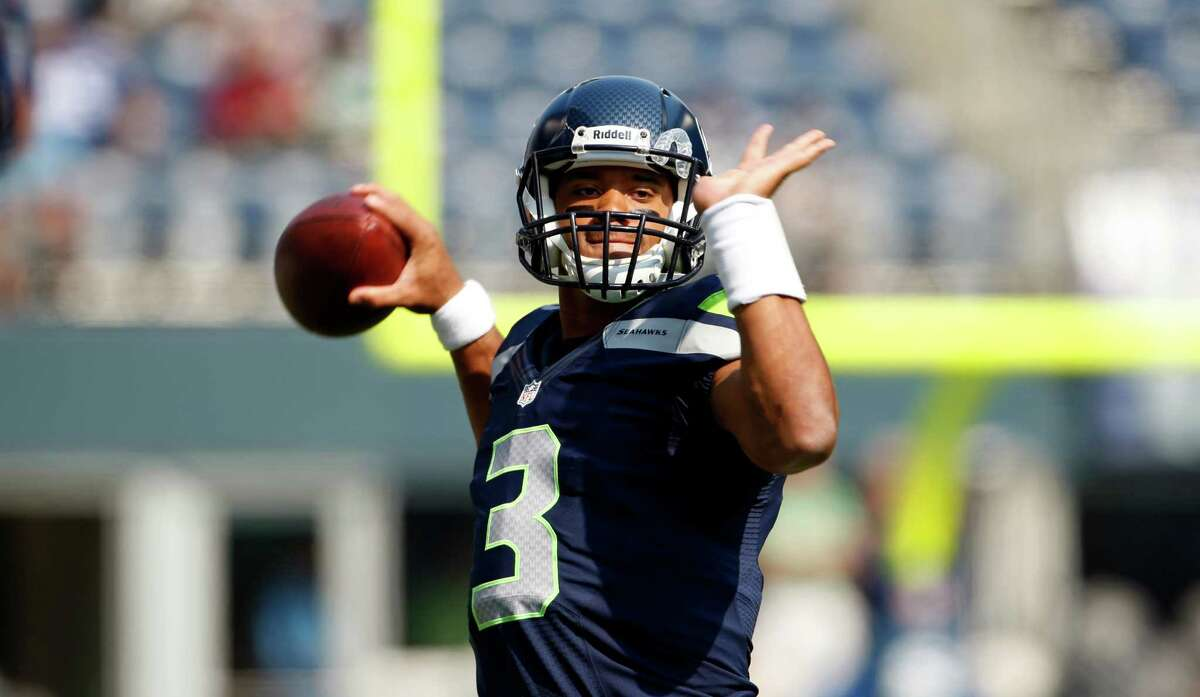 Seattle Seahawks quarterback Russell Wilson warms-up before an NFL football game against the Dallas Cowboys Sunday, Sept. 16, 2012, in Seattle.
