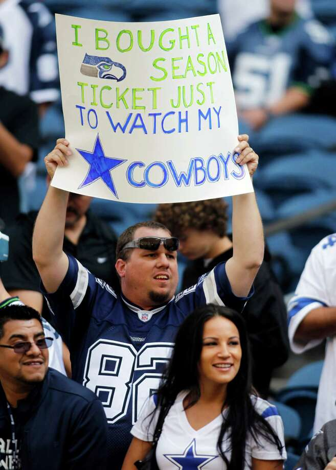 A Dallas Cowboys fan holds a sign before an NFL football game against the Seattle Seahawks, Sunday, Sept. 16, 2012, in Seattle. Photo: AP
