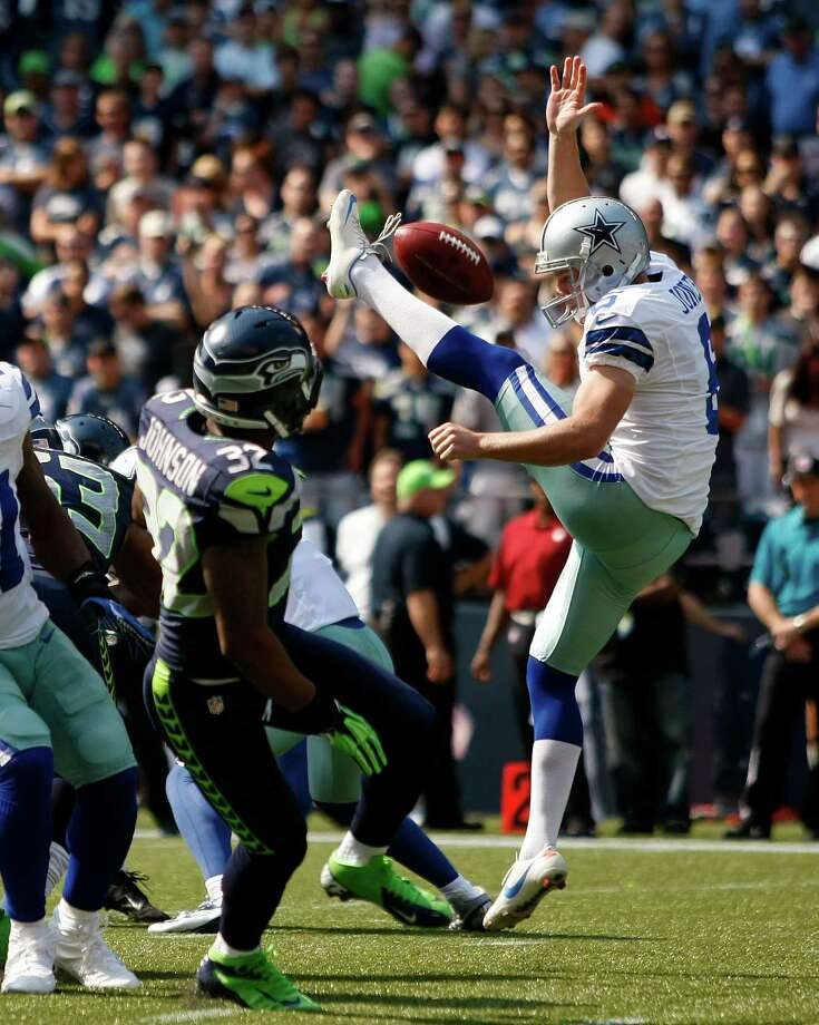 Dallas Cowboys' Chris Jones, right, has his punt blocked as Seattle Seahawks' Jeron Johnson moves in to grab it and run it in for a touchdown in the first half of an NFL football game on Sunday, Sept. 16, 2012, in Seattle. Photo: AP