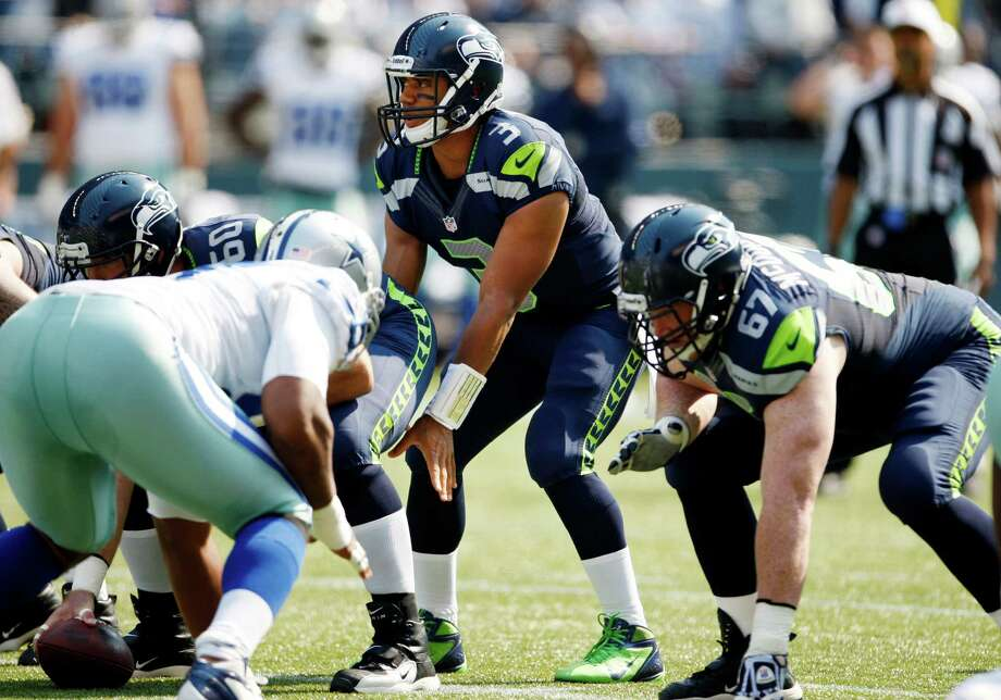 Seattle Seahawks quarterback Russell Wilson lines up on the team's first play against the Dallas Cowboys in the first half of an NFL football game, Sunday, Sept. 16, 2012, in Seattle. Photo: AP