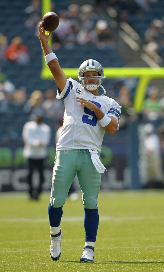 Dallas Cowboys quarterback Tony Romo warms-up before an NFL football game against the Seattle Seahawks, Sunday, Sept. 16, 2012, in Seattle. Photo: AP
