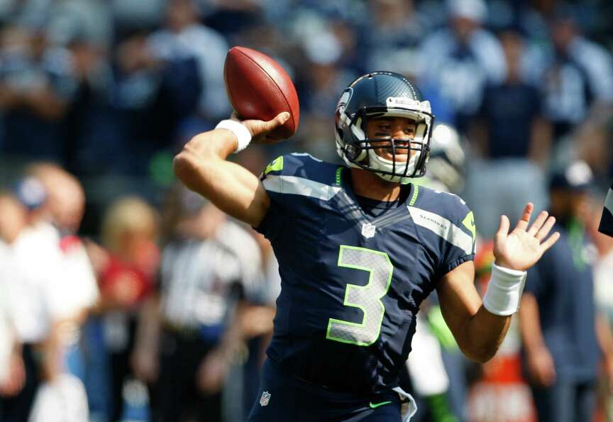 Seattle Seahawks quarterback Russell Wilson warms up before an NFL football game against the Dallas