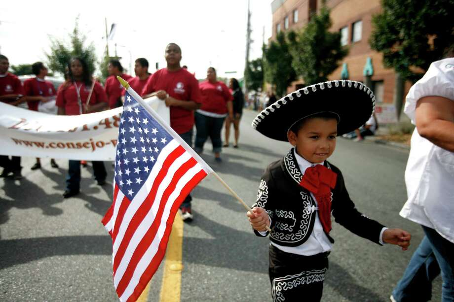 A young boy wears a traditional outfit. Photo: Sofia Jaramillo / SEATTLEPI.COM