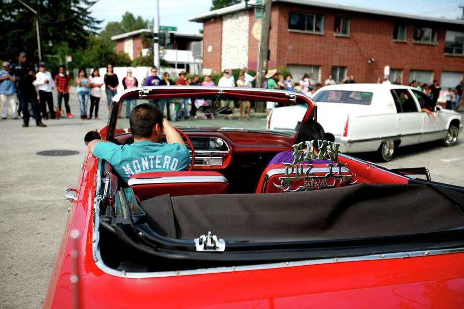 A car from the Eazy Duz It Car Club rolls through South Park. Photo: Sofia Jaramillo / SEATTLEPI.COM