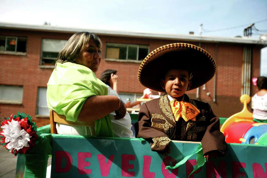 A young boy is shown riding a float. Photo: Sofia Jaramillo / SEATTLEPI.COM