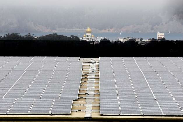 Solar panels cover the roof of San Francisco's Sunset Reservoir. The Board of Supervisors is set to consider legislation Tuesday that would allocate $19.5 million to establish the CleanPowerSF program. Photo: Michael Macor, The Chronicle / SF