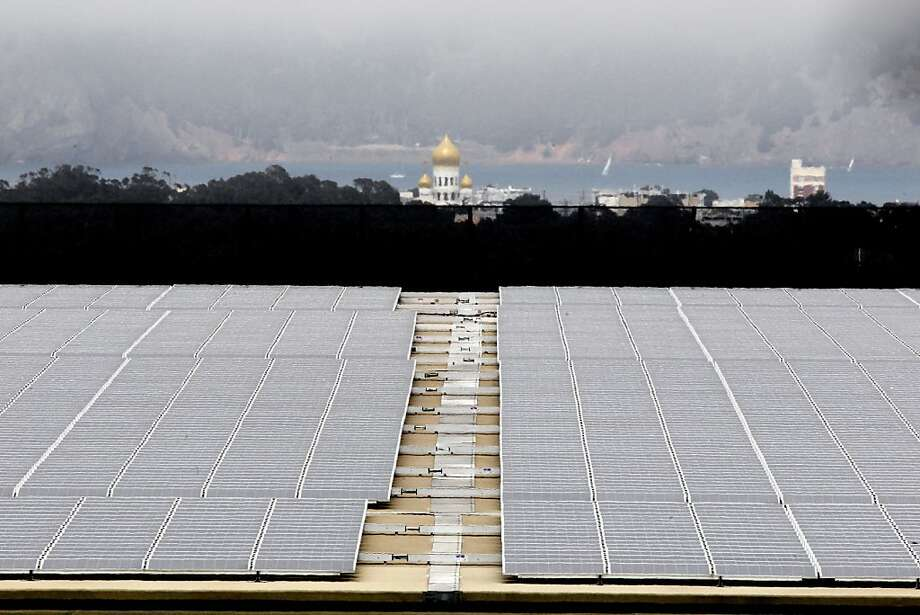 Solar panels cover the roof of San Francisco's Sunset Reservoir. The Board of Supervisors is set to consider legislation Tuesday that would allocate $19.5 million to establish the CleanPowerSF program. Photo: Michael Macor, The Chronicle