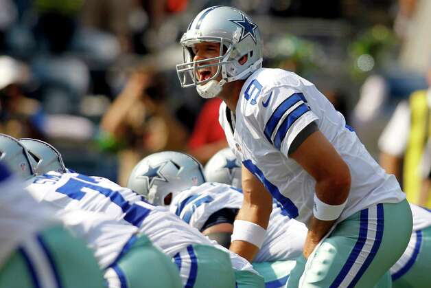 Dallas Cowboys quarterback Tony Romo yells out from the line of scrimmage against the Seattle Seahawks in the first half of an NFL football game, Sunday, Sept. 16, 2012, in Seattle. (AP Photo/John Froschauer) Photo: John Froschauer, Associated Press / FR74207 AP