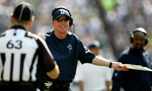 Dallas Cowboys head coach Jason Garrett has words with an official in the first half of an NFL football game against the Seattle Seahawks, Sunday, Sept. 16, 2012, in Seattle. (AP Photo/John Froschauer) Photo: John Froschauer, Associated Press / FR74207 AP