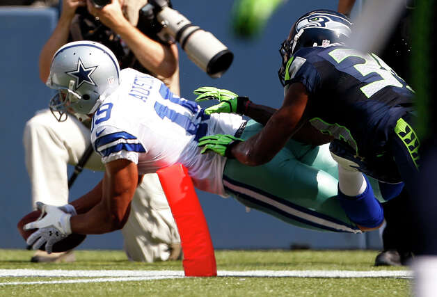 Dallas Cowboys' Miles Austin, left, dives into the end zone for a touchdown as Seattle Seahawks' Brandon Browner follows in the first half of an NFL football game on Sunday, Sept. 16, 2012, in Seattle. (AP Photo/Kevin P. Casey) Photo: Kevin P. Casey, Associated Press / FR132181 AP
