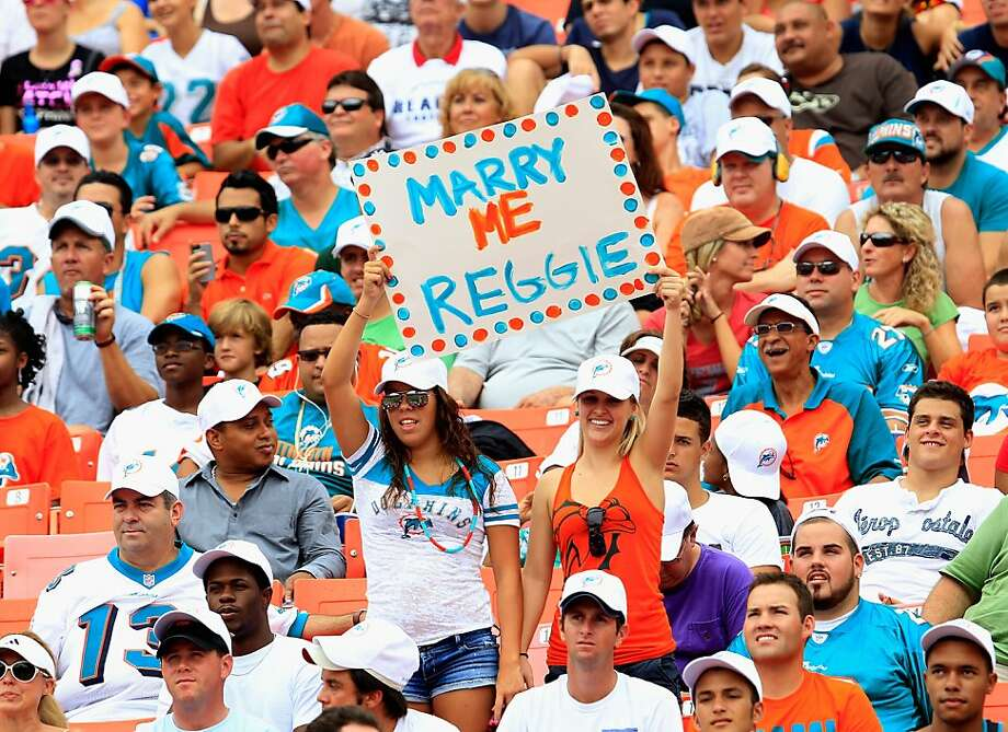 MIAMI GARDENS, FL - SEPTEMBER 16: Miami Dolphins fans hold a sign at the game against the Oakland Raiders at Sun Life Stadium on September 16, 2012 in Miami Gardens, Florida.  (Photo by Chris Trotman/Getty Images) Photo: Chris Trotman, Getty Images