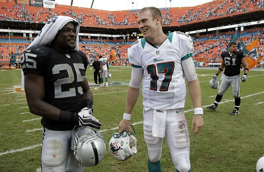 Oakland Raiders running back Mike Goodson (25) talks with Miami Dolphins quarterback Ryan Tannehill (17) after their NFL  football game, Sunday, Sept. 16, 2012 in Miami , FL. The Dolphins defeated the Raiders 35-13. (AP Photo/Lynne Sladky) Photo: Lynne Sladky, Associated Press