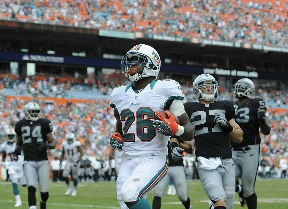 Miami Dolphins Lamar Miller scores a touchdown during the second half of an NFL football game against the Oakland Raiders,  Sunday, Sept. 16, 2012 in Miami. (AP Photo/Rhona Wise) Photo: Rhona Wise, Associated Press