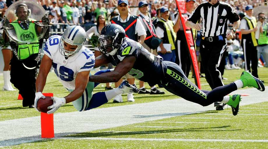 Dallas Cowboys wide receiver Miles Austin, left, dives across the goal line for a touchdown as Seattle Seahawks' Brandon Browner defends in the first half of an NFL football game, Sunday, Sept. 16, 2012, in Seattle. Photo: AP