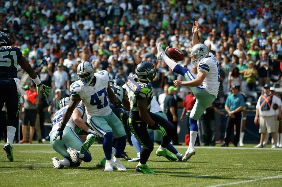 Dallas Cowboys' Chris Jones has his punt blocked as Seattle Seahawks' Jeron Johnson moves in to grab it and run it in for a touchdown in the first half of an NFL football game, Sunday, Sept. 16, 2012, in Seattle. Photo: AP