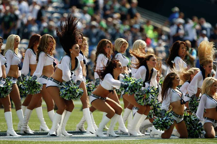 Seattle cheerleaders perform before the NFL football game between the Dallas Cowboys Seattle Seahawk