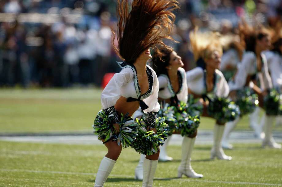 Seattle cheerleaders perform before the NFL football game between the Dallas Cowboys Seattle Seahawks Sunday, Sept. 16, 2012, in Seattle. Photo: AP