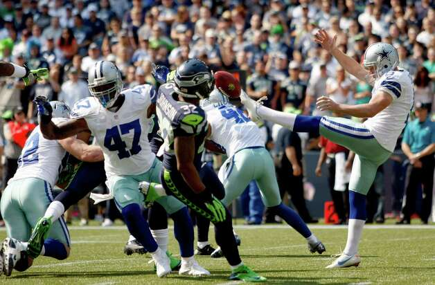 Dallas Cowboys' Chris Jones has his punt blocked as Seattle Seahawks' Jeron Johnson (32) moves in to grab it and run it in for a touchdown in the first half of an NFL football game, Sunday, Sept. 16, 2012, in Seattle. (AP Photo/John Froschauer) Photo: John Froschauer, Associated Press / FR74207 AP
