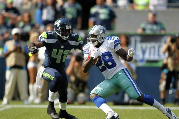 Dallas Cowboys' Felix Jones returns a kick with Seattle Seahawks' Byron Maxwell defending in the first half of an NFL football game, Sunday, Sept. 16, 2012, in Seattle. (AP Photo/John Froschauer) Photo: John Froschauer, Associated Press / FR74207 AP