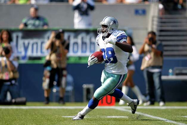Dallas Cowboys' Felix Jones returns a kick against the Seattle Seahawks in the first half of an NFL football game, Sunday, Sept. 16, 2012, in Seattle. (AP Photo/John Froschauer) Photo: John Froschauer, Associated Press / FR74207 AP