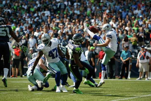 Dallas Cowboys' Chris Jones has his punt blocked as Seattle Seahawks' Jeron Johnson moves in to grab it and run it in for a touchdown in the first half of an NFL football game, Sunday, Sept. 16, 2012, in Seattle. (AP Photo/John Froschauer) Photo: John Froschauer, Associated Press / FR74207 AP