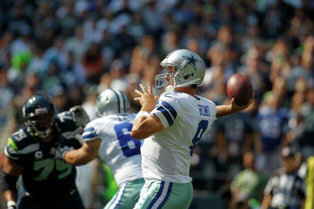 Dallas Cowboys quarterback Tony Romo in action against the Seattle Seahawks in the first half of an NFL football game, Sunday, Sept. 16, 2012, in Seattle. (AP Photo/John Froschauer) Photo: John Froschauer, Associated Press / FR74207 AP