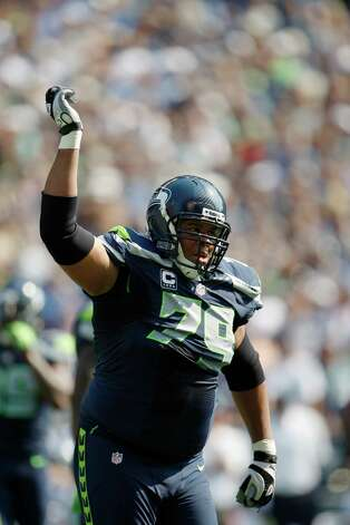 Seattle Seahawks' Red Bryant runs with his hand up on the field against the Dallas Cowboys in the first half of an NFL football game, Sunday, Sept. 16, 2012, in Seattle. (AP Photo/Kevin P. Casey) Photo: Kevin P. Casey, Associated Press / FR132181 AP
