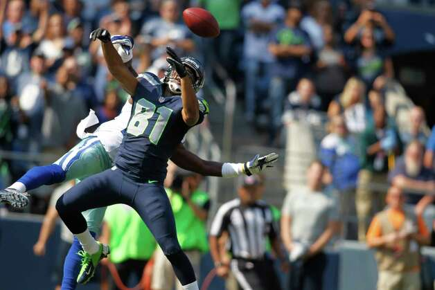 Seattle Seahawks' Golden Tate is unable to catch a pass under pressure from a Dallas Cowboys defender in the first half of an NFL football game, Sunday, Sept. 16, 2012, in Seattle. (AP Photo/John Froschauer) Photo: John Froschauer, Associated Press / FR74207 AP
