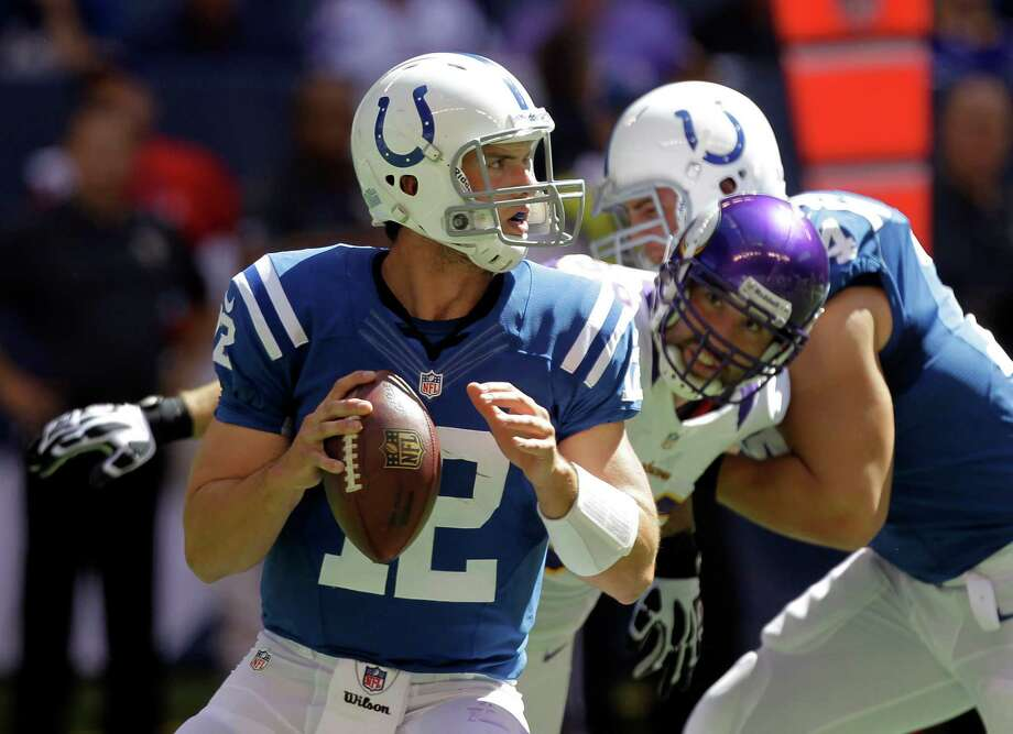 Indianapolis Colts' Andrew Luck looks to pass during the first half of an NFL football game against the Minnesota Vikings in Indianapolis, Sunday, Sept. 16, 2012. (AP Photo/Michael Conroy) Photo: Michael Conroy / AP
