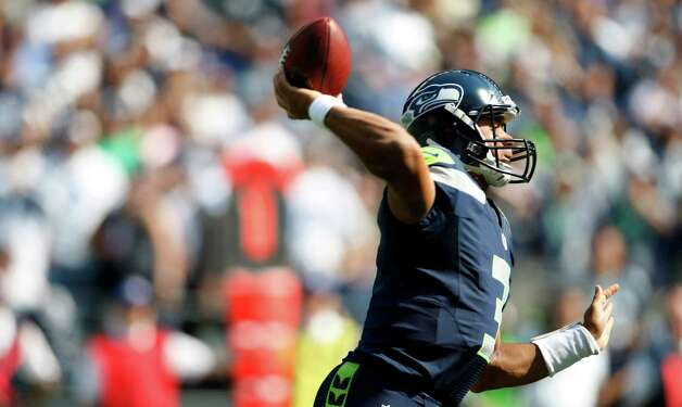Seattle Seahawks quarterback Russell Wilson in action against the Dallas Cowboys in the first half of an NFL football game, Sunday, Sept. 16, 2012, in Seattle. (AP Photo/Kevin P. Casey) Photo: Kevin P. Casey, Associated Press / FR132181 AP
