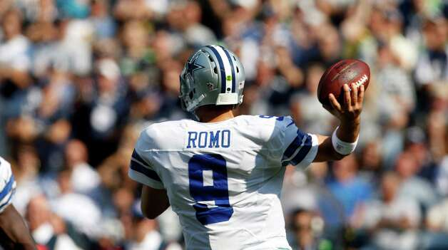 Dallas Cowboys quarterback Tony Romo in action against the Seattle Seahawks in the first half of an NFL football game, Sunday, Sept. 16, 2012, in Seattle. (AP Photo/Kevin P. Casey) Photo: Kevin P. Casey, Associated Press / FR132181 AP