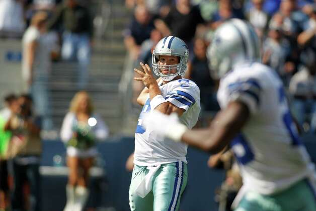 Dallas Cowboys Tony Romo makes a pass to DeMarco Murray against the Seattle Seahawks in the first half of an NFL football game, Sunday, Sept. 16, 2012, in Seattle. (AP Photo/John Froschauer) Photo: John Froschauer, Associated Press / FR74207 AP