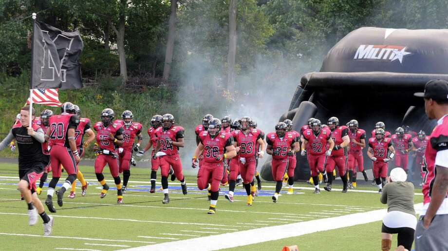Western Connecticut Militia semi-pro football team enters the field to play against the Connecticut Bearcats on Sunday September 16, 2012 at Immaculate High School in Danbury. Photo: Lisa Weir