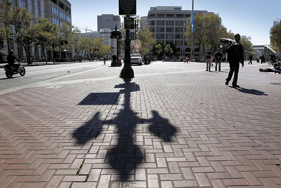 U.N. Plaza, above, and Hallidie Plaza, right, are among the public squares on Market Street. The thoroughfare will be the focus of what could be a two-year, $20 million repaving project. Photo: Michael Macor, The Chronicle