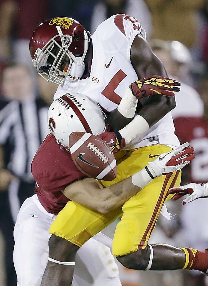 This jarring hit by Stanford safety Ed Reynolds on USC wide receiver Nelson Agholor typified the kind of defense the Cardinal displayed all game. Photo: Marcio Jose Sanchez, Associated Press