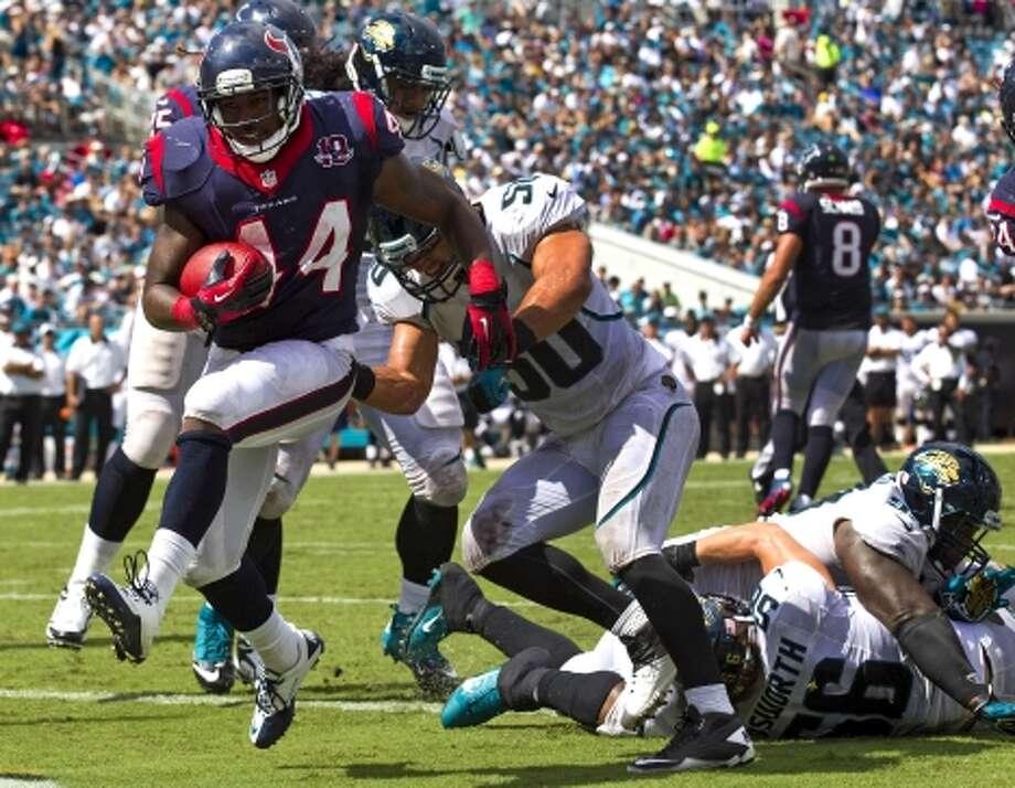 Running back Ben Tate runs past Jacksonville Jaguars outside linebacker Russell Allen (50) for a 2-yard touchdown. (Brett Coomer / © 2012  Houston Chronicle)