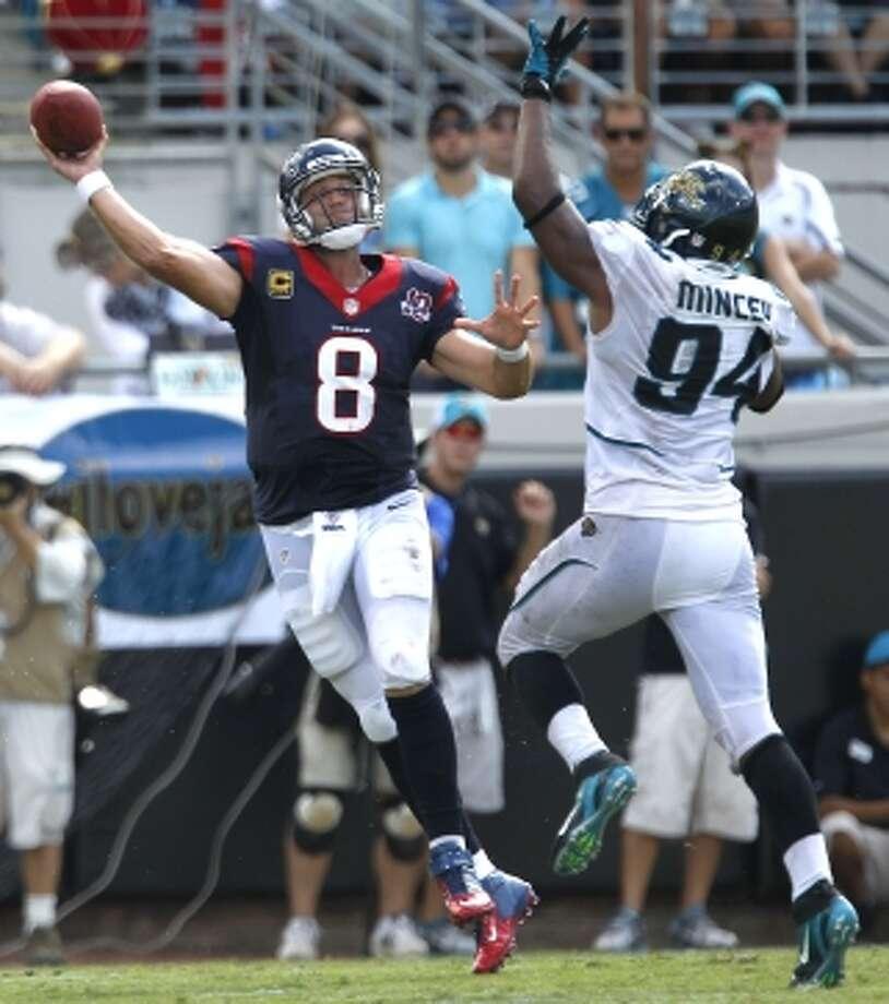 Matt Schaub throws a pass under duress.  (Brett Coomer / © 2012  Houston Chronicle)