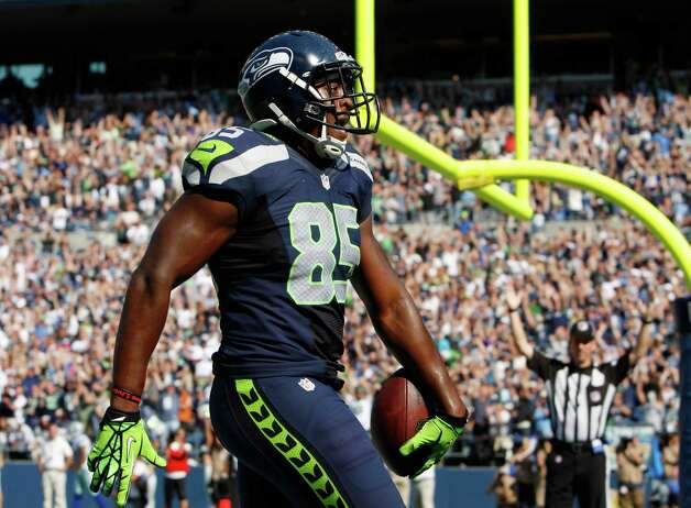 Seattle Seahawks' Anthony McCoy runs through the end zone as he scores against the Dallas Cowboys in the second half of an NFL football game on Sunday, Sept. 16, 2012, in Seattle. (AP Photo/Kevin P. Casey) Photo: Kevin P. Casey, Associated Press / FR132181 AP